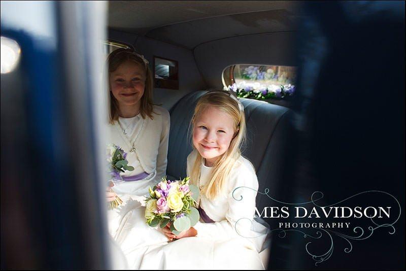bridesmaids in wedding car
