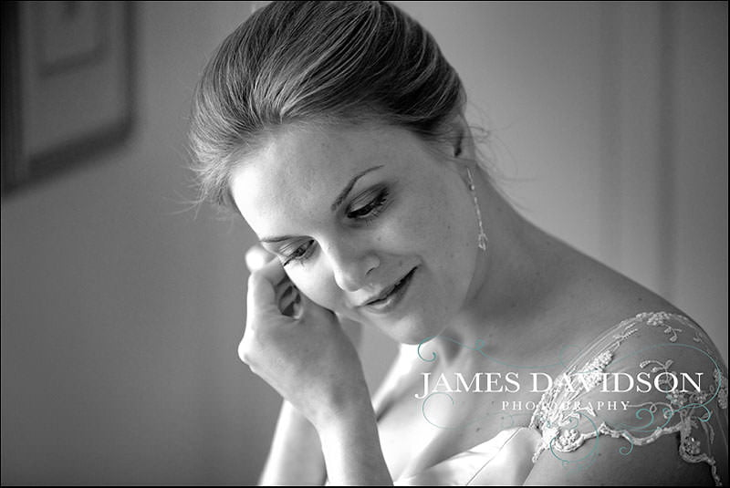 bride putting on ear rings