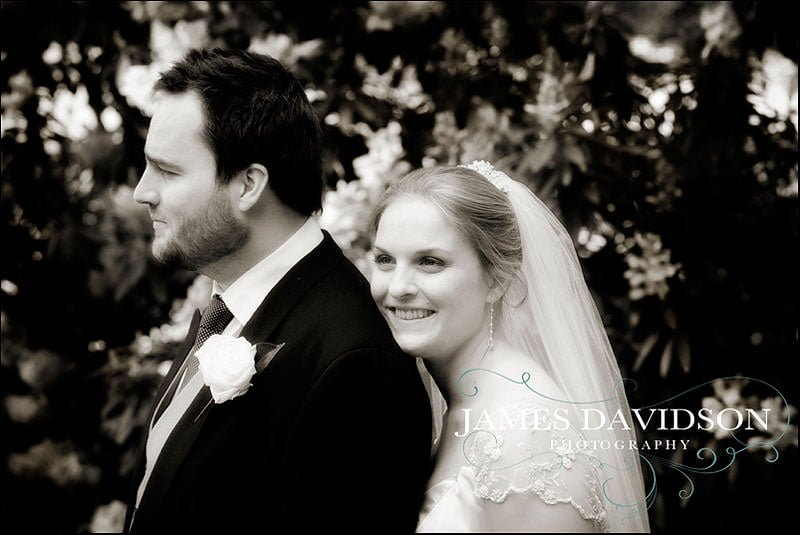 bride and groom amongst the flowers